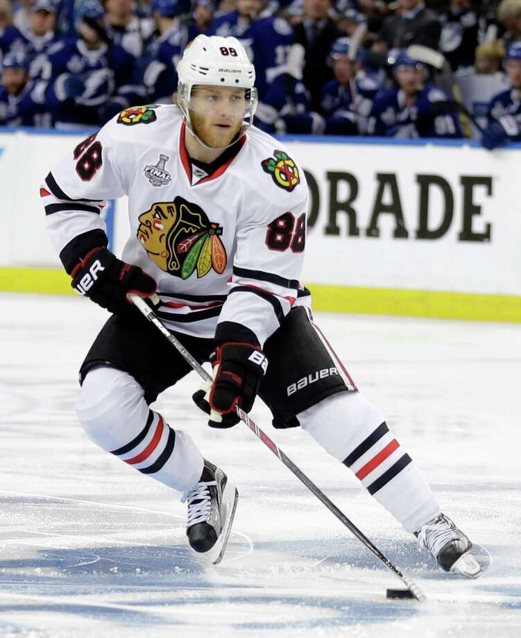 """FILE - In this June 6, 2015, file photo, Chicago Blackhawks right wing Patrick Kane skates against the Tampa Bay Lightning during the second period in Game 2 of the NHL hockey Stanley Cup Final in Tampa, Fla. The NHL says it is """"following developments"""" of a police investigation involving Chicago Blackhawks star Patrick Kane, Thursday, Aug. 6, 2015. (AP Photo/Chris O'Meara, File) ORG XMIT: NY168 Photo: Chris O'Meara / AP"""