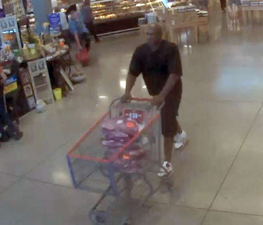 Police believe footage shows James Cordell Avery pushing a cart full of meat through a grocery store. Photo:  Austin Police Department /  Austin Police Department