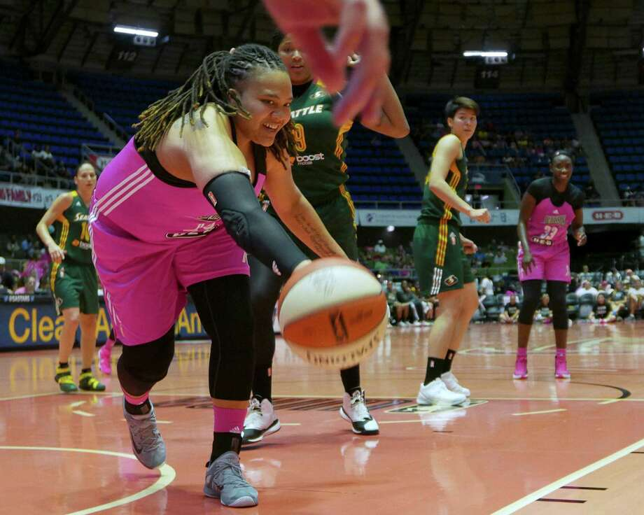 Danielle Adams of the San Antonio Stars reaches for a loose ball during WNBA action against the Seattle Storm at Freeman Coliseum on Saturday, Aug. 8, 2015. Photo: Billy Calzada, Staff / San Antonio Express-News / San Antonio Express-News
