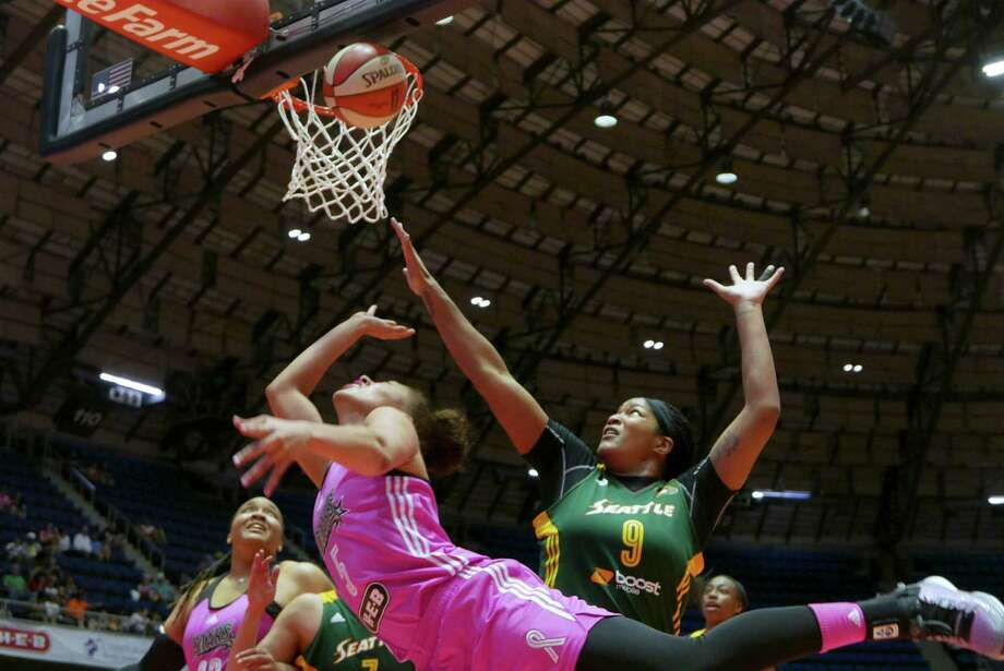 Dearica Hamby of the San Antonio Stars (5) drives around Markeisha Gatling (9) of the Seattle Storm during WNBA action at Freeman Coliseum on Aug. 8, 2015. Photo: Billy Calzada /San Antonio Express-News / San Antonio Express-News