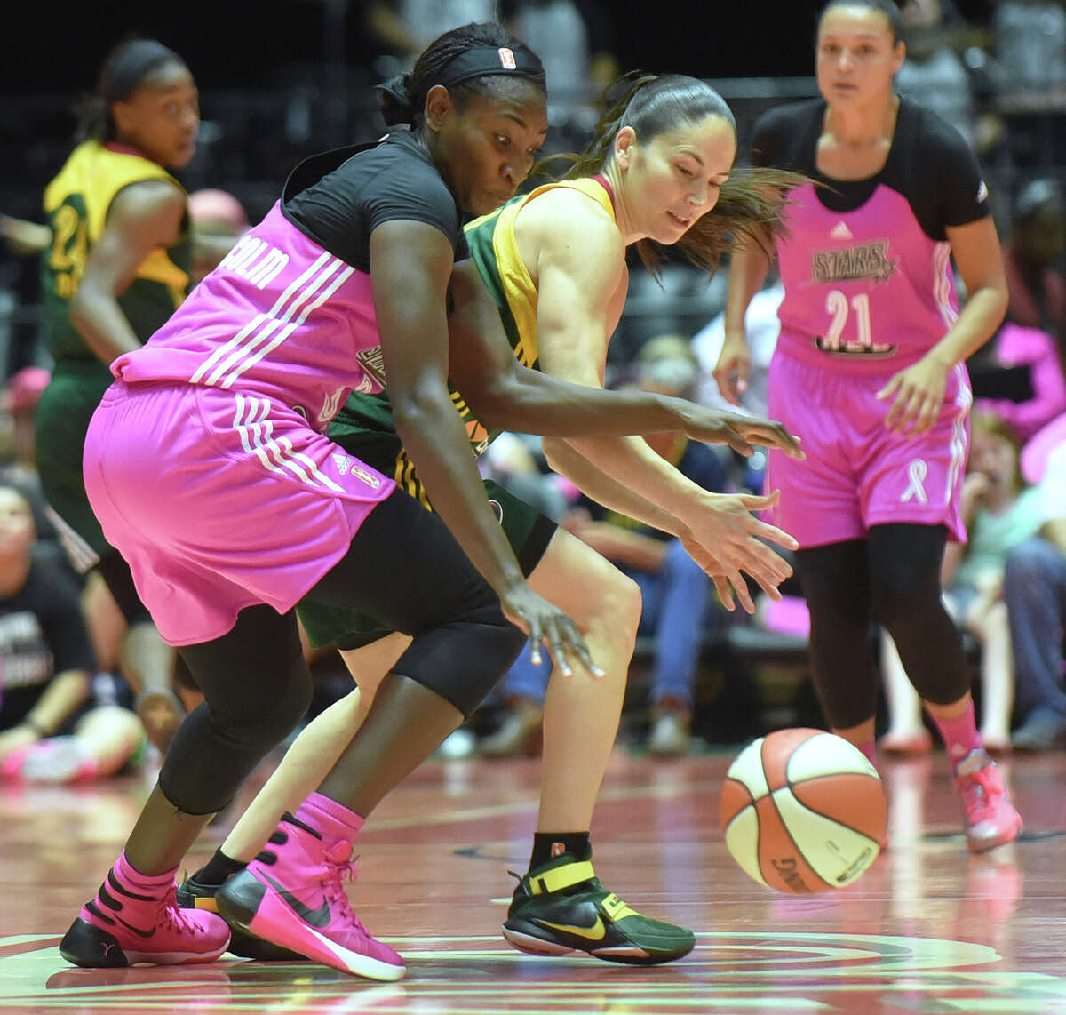 Sophia Young-Malcolm of the San Antonio Stars steals the ball from Sue Bird of the Seattle Storm during WNBA action at Freeman Coliseum on Saturday, Aug. 8, 2015.