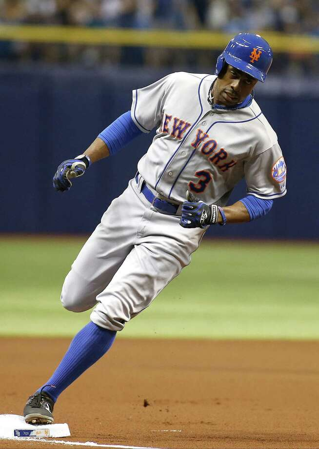ST. PETERSBURG, FL - AUGUST 8:  Curtis Granderson #3 of the New York Mets rounds third base after hitting a home run off of pitcher Nathan Karns #51 of the Tampa Bay Rays during the first inning of a game on August 8, 2015 at Tropicana Field in St. Petersburg, Florida.  (Photo by Brian Blanco/Getty Images) ORG XMIT: 538588367 Photo: Brian Blanco / 2015 Getty Images