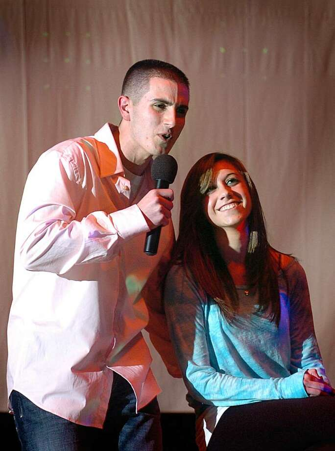 Steve Loschiavo serenades girlfriend Mallory Morlando on stage during the talent portion of St. Joseph's fourth annual Mr. Student Body Competition Thursday Mar. 18, 2010 at the school in Trumbull.  Proceeds benefit the Center for Women and Families of Bridgeport and their White Ribbon Campaign, in which men and boys oppose violence against women. Photo: Autumn Driscoll / Connecticut Post