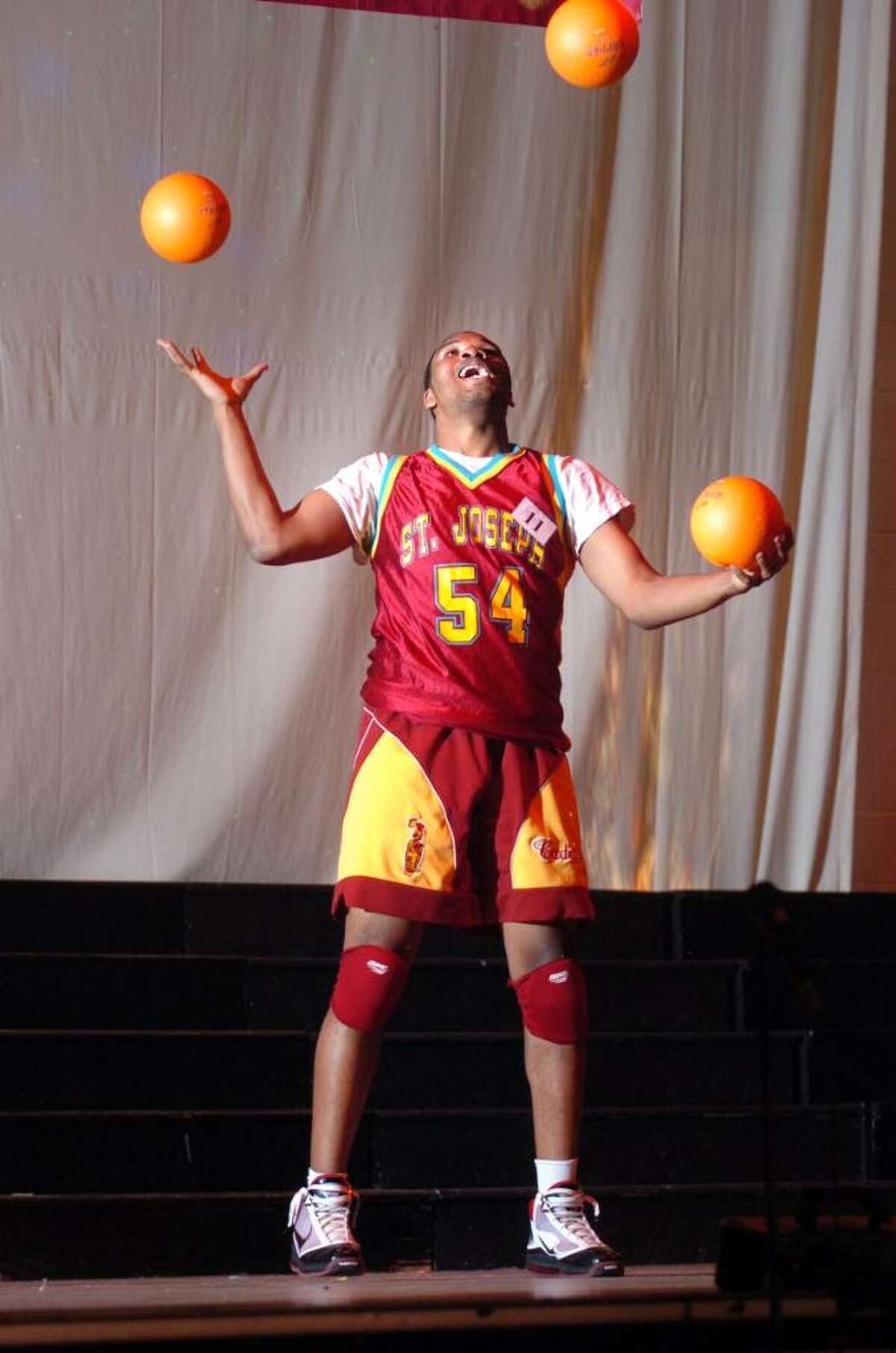 Greg Langston shows off his juggling talent at St. Joseph's fourth annual Mr. Student Body Competition Thursday Mar. 18, 2010 at the school in Trumbull. Proceeds benefit the Center for Women and Families of Bridgeport and their White Ribbon Campaign, in which men and boys oppose violence against women.