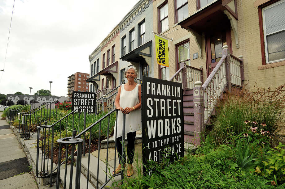 Current city corporation counsel Kathryn Emmett in front of Frankliln Street Works in Stamford. Emmett founded the modern art gallery and cafe space next to her law offices. She bought four of the five row houses on Franklin Street in the late 1980s. Photo: Jason Rearick / Hearst Connecticut Media / Stamford Advocate