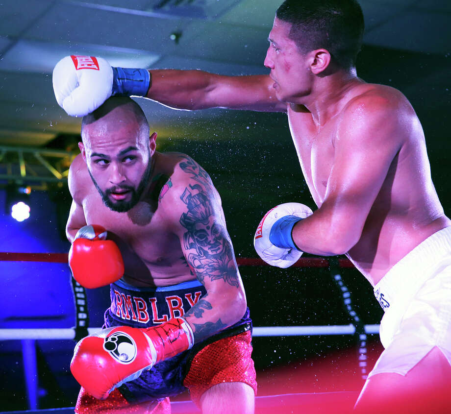 James Leija, Jr. ducks a punch during his pro boxing debut against Cesar Martinez at the San Antonio Event Center on August 8, 2015. Photo: San Antonio Express-News