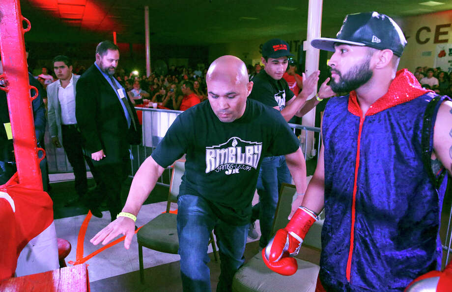 "Jesse"" James Leija climbs into the ring ahead of his son James Leija Jr., who made hist pro boxing debut against Cesar Martinez at the San Antonio Event Center on Aug. 8, 2015. Photo: Tom Reel /San Antonio Express-News"