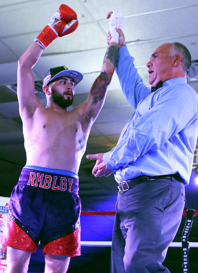 James Leija, Jr. gets the decision after his pro boxing debut against Cesar Martinez at the San Antonio Event Center on Aug. 8, 2015. Photo: Tom Reel /San Antonio Express-News