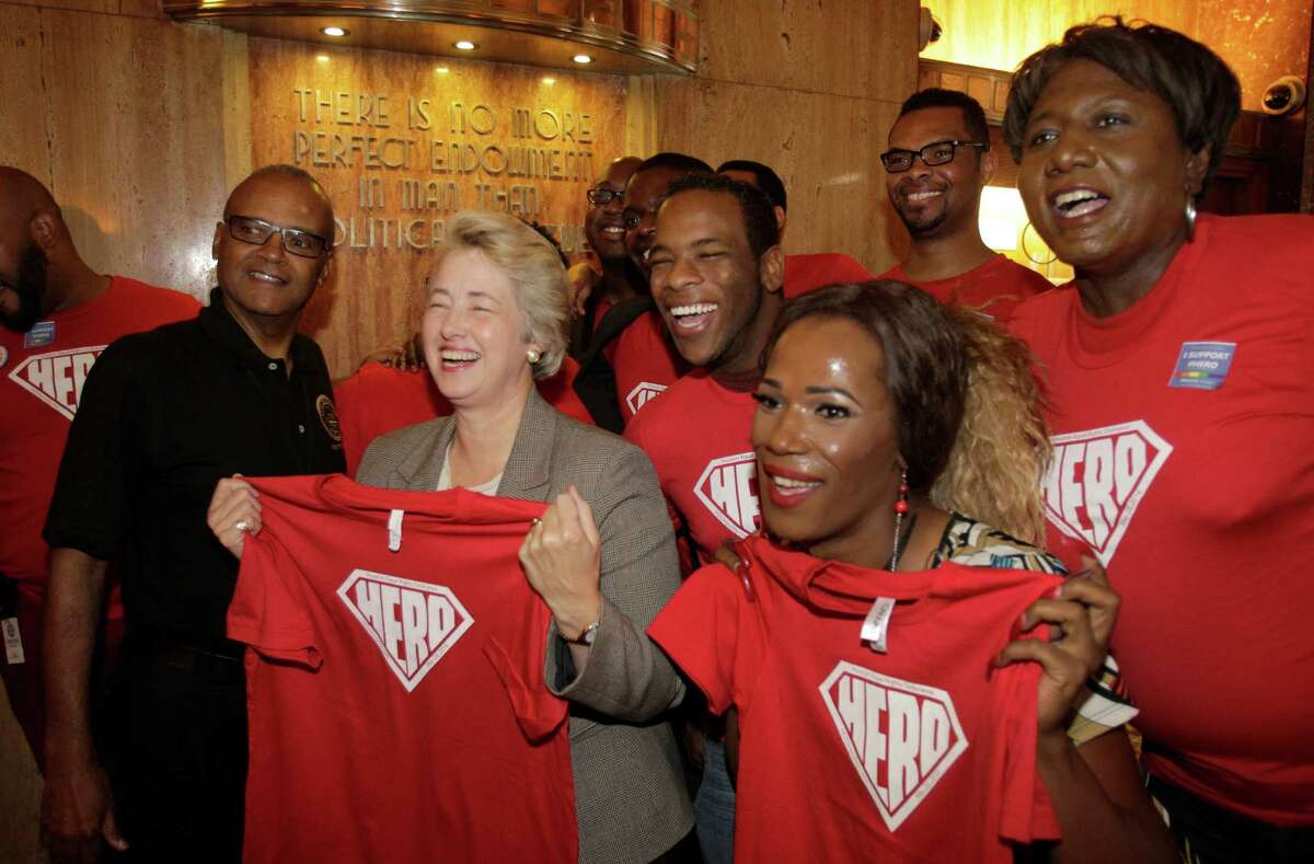 Mayor Annise Parker and supporters of Houston's Equal Rights Ordinance were all smiles after a news conference last month.
