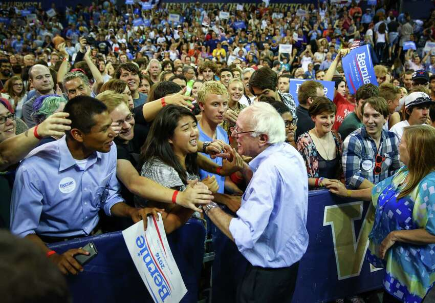 Bernie Sanders shakes hands with supporters during a rally at Hec Ed Pavilion that drew an estimated 15,000 people to the University of Washington. The rally filled the arena and left thousands outside. Earlier in the day Sanders participation in a rally at Westlake Park was cut short because protesters took over the microphone. Photographed on Saturday, August 8, 2015.