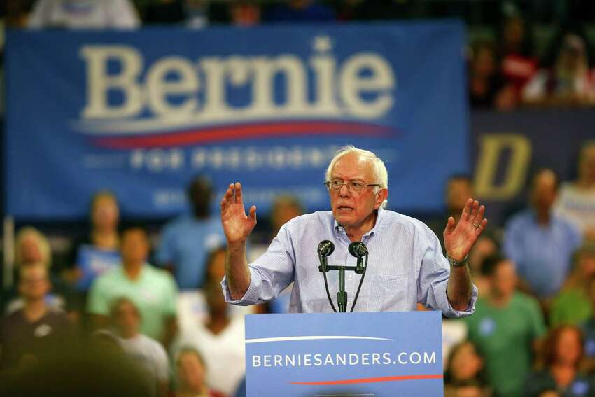 Bernie Sanders speaks during a rally at Hec Ed Pavilion that drew an estimated 15,000 people to the University of Washington. The rally filled the arena and left thousands outside. Earlier in the day Sanders participation in a rally at Westlake Park was cut short because protesters took over the microphone. Photographed on Saturday, August 8, 2015.