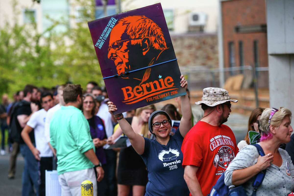 Bernie Sanders supporters wait outside of Hec Ed Pavilion for a rally that drew an estimated 15,000 people to the University of Washington. The rally filled the arena and left thousands outside. Earlier in the day Sanders participation in a rally at Westlake Park was cut short because protesters took over the microphone. Photographed on Saturday, August 8, 2015.