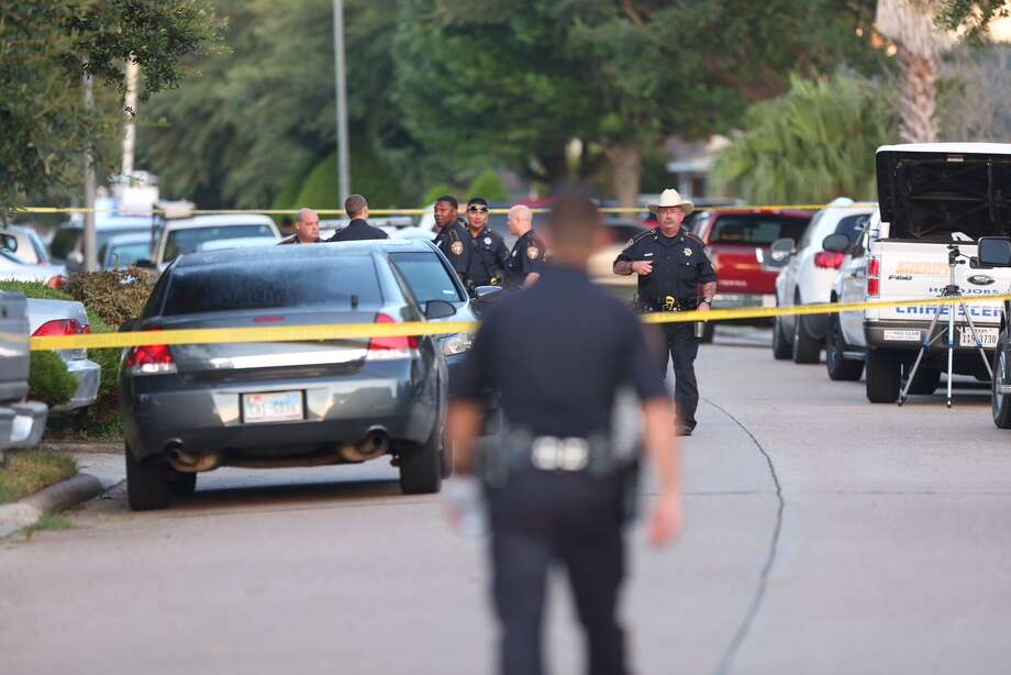 Harris County Sheriffs Office deputies investigate after finding eight people dead inside a home in the 2200 block of Falling Oaks Road, Sunday, August 9, in Houston. Three adults and five children are dead, and a 49-year old male suspect surrendered. Photo: Jon Shapley / Houston Chronicle