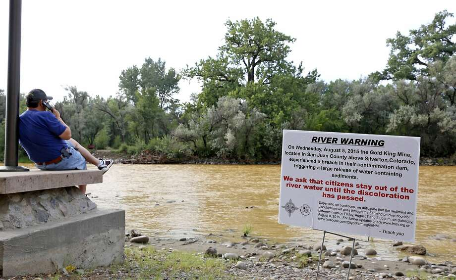 A sign warns of Animas River contamination. About a million gallons of wastewater from a Colorado mine began spilling into the river Wednesday. Photo: Alexa Rogals, Associated Press