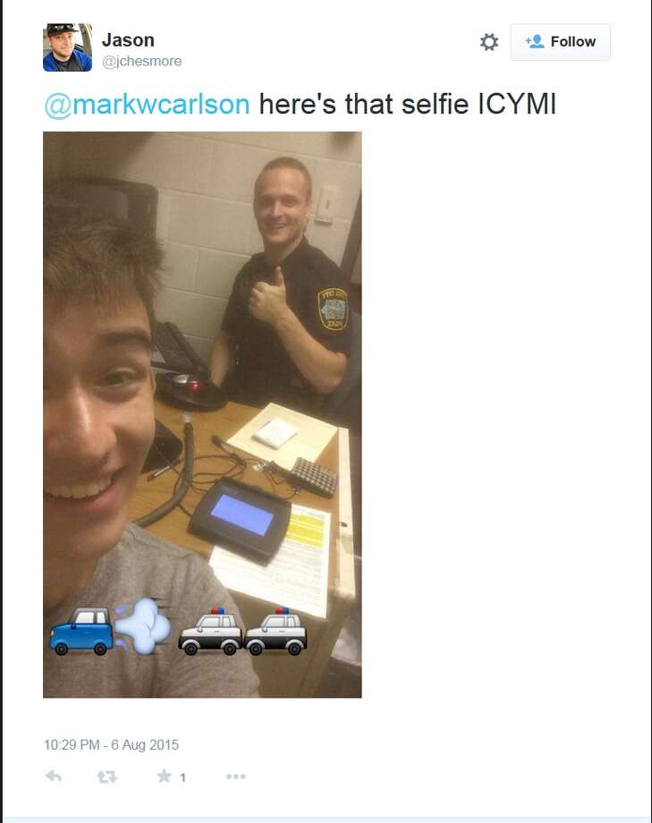 Gilbert Phelps' original selfie, emojis and all, with his arresting officer that was shared around Twitter. Photo: Twitter Screen Grab