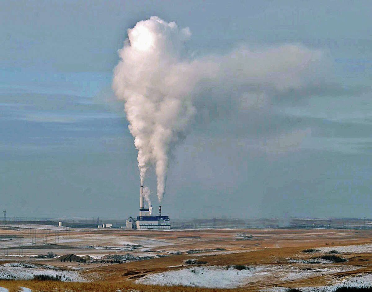 """FILE - In this Jan. 30, 2008 file photo, steam rises from the Milton Young Power Plant near Center, N.D. North Dakota Attorney Gen. Wayne Stenehjem says the state """"is very seriously considering"""" a legal fight against new federal rules designed to cut greenhouse gas emissions from U.S. power plants. The Trump administration has moved to roll back the rules, called the Clean Power Plan. )"""
