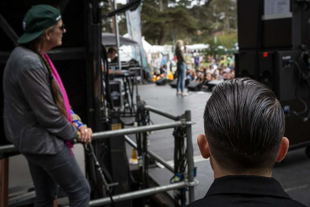 Bay Area rapper G-Eazy and mother Suzanne Olmsted watch singer Devon Baldwin perform from backstage at Outside Lands Music Festival on Saturday, Aug. 8, 2015.