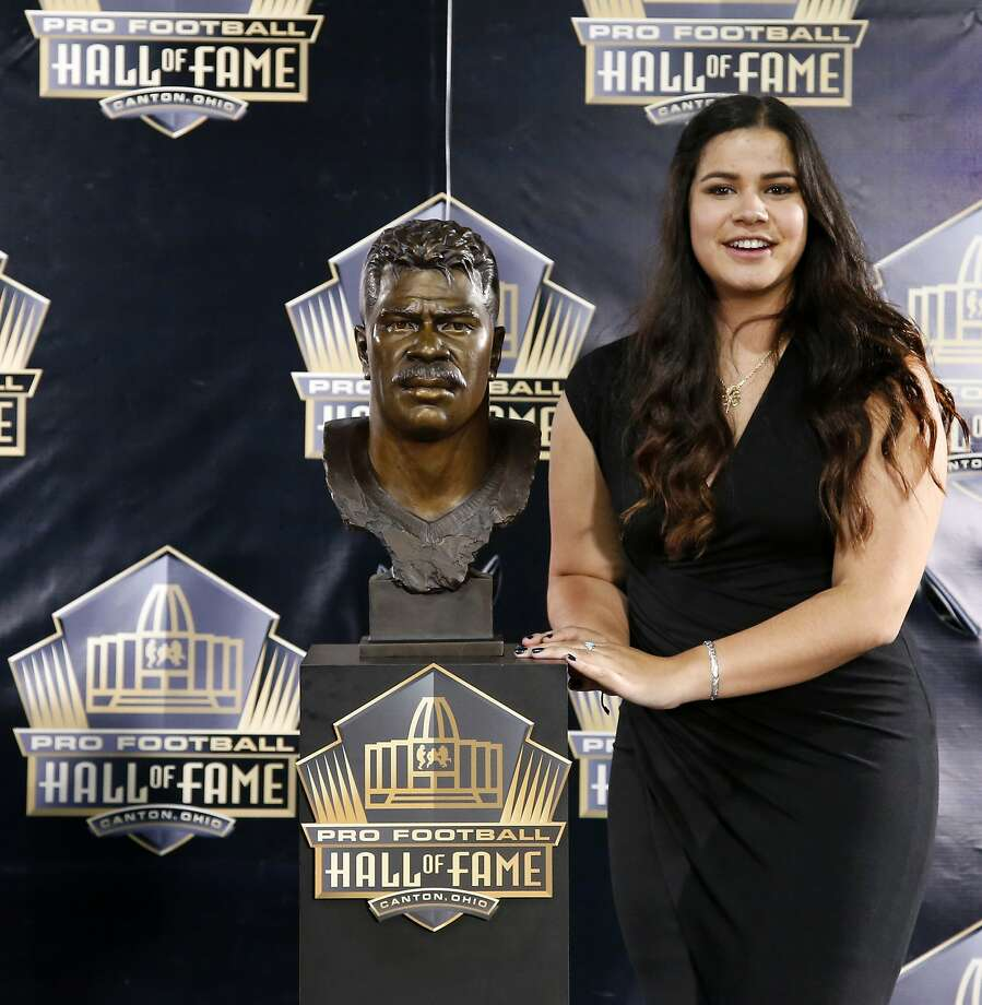 Sydney Seau, aughter of former NFL player Junior Seau, poses with a bust of her father during inductions at the Pro Football Hall of Fame Saturday, Aug. 8, 2015, in Canton, Ohio. (AP Photo/Gene J. Puskar) Photo: Gene J. Puskar, Associated Press