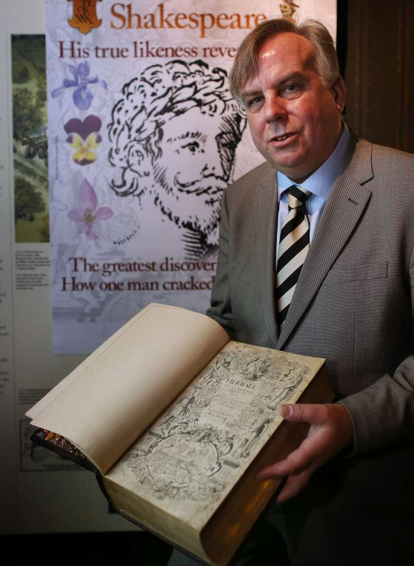 Shakespeare the herb...alist? Getty caption: Historian Mark Griffiths holds a copy of The Herball book that contains what is thought to be the first authenticated living portrait of William Shakespeare at The Rose Theatre on May 19, 2015 in London, England. Botanist and historian Mark Griffiths has revealed he has cracked a many-layered Tudor code and revealed the living face of Shakespeare for the first time, on the title page of the first edition of The Herball, a 16th century book on plants, 400 years after it was first published. (Photo by Peter Macdiarmid/Getty Images)