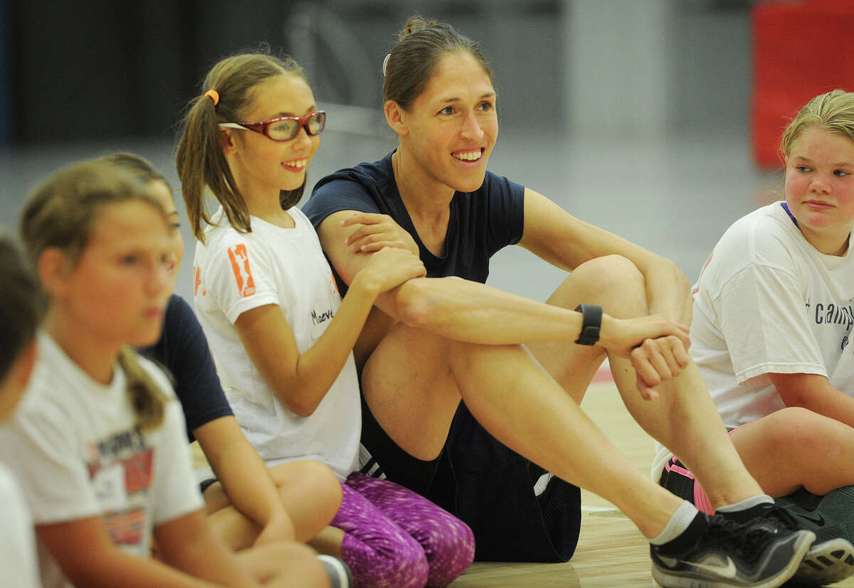 Maeve Rushin, 8, of Granby, sits with her mom, former UCONN and WNBA women's basketball star Rebecca Lobo, during Lobo's Clinic Against Cancer basketball clinic for girls at Sacred Heart University in Fairfield, Conn. on Sunday, August 9, 2015. Dozens of girls participated in the event with all of the proceeds going to benefit the Connecticut Sports Foundation Against Cancer.
