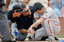 CHICAGO, IL - AUGUST 09: Nori Aoki #23 of the San Francisco Giants is checked by medical staff after being hit in the head with a pitch during the third inning at Wrigley Field on August 9, 2015 in Chicago, Illinois.  (Photo by Jon Durr/Getty Images)