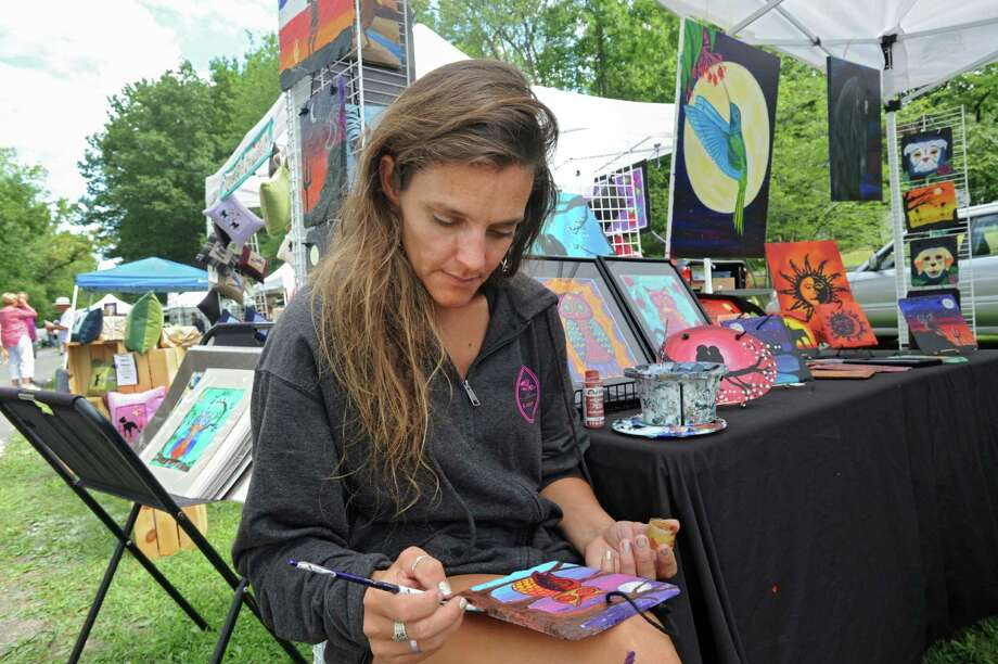Vendor Kimberly Leahey of Kilaarts studio paints a Mexican folk owl on a piece of slate during the Round Lake Arts & Crafts Festival and Book Sale on Sunday, Aug. 9, 2015 in Round Lake, N.Y.  (Lori Van Buren / Times Union) Photo: Lori Van Buren / 10032895A