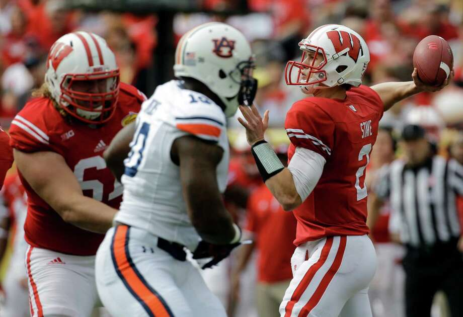 Wisconsin quarterback Joel Stave (2) throws a pass against Auburn during the first quarter of the Outback Bowl NCAA college football game Thursday, Jan. 1, 2015, in Tampa, Fla. (AP Photo/Chris O'Meara) Photo: Chris O'Meara, STF / Associated Press / AP