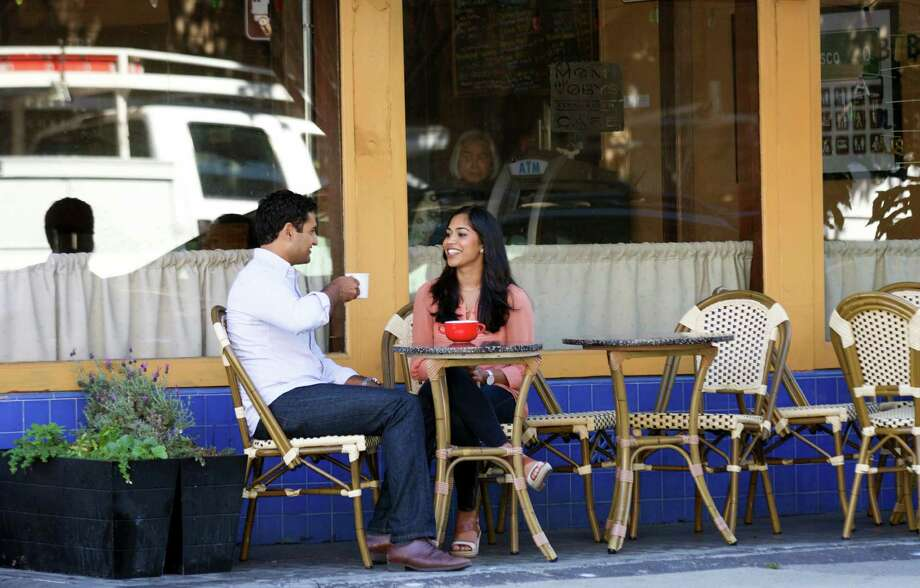 Kunal Modi and his wife, Anita Gupta, talk at a coffee shop near their home in San Francisco. Millennial men, such as Modi, have much more egalitarian attitudes about family, career and gender roles inside marriage than generations before them, but as they enter that more responsibility-filled stage of life, their roles often become more traditional. Photo: Thor Swift /New York Times / NYTNS