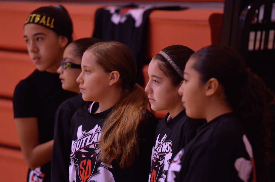 Members of the San Antonio Outlaws wait for a recent tournament game to begin. Photo: Robin Jerstad / San Antonio Express-News