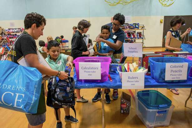 The inaugural Back To School Shop event where economically disadvantaged elementary school students get to pick out their own clothes and school supplies which are free with the help of a volunteer personal shopper. The event was held at the Davenport Ridge Elementary School in Samford on Sunday .