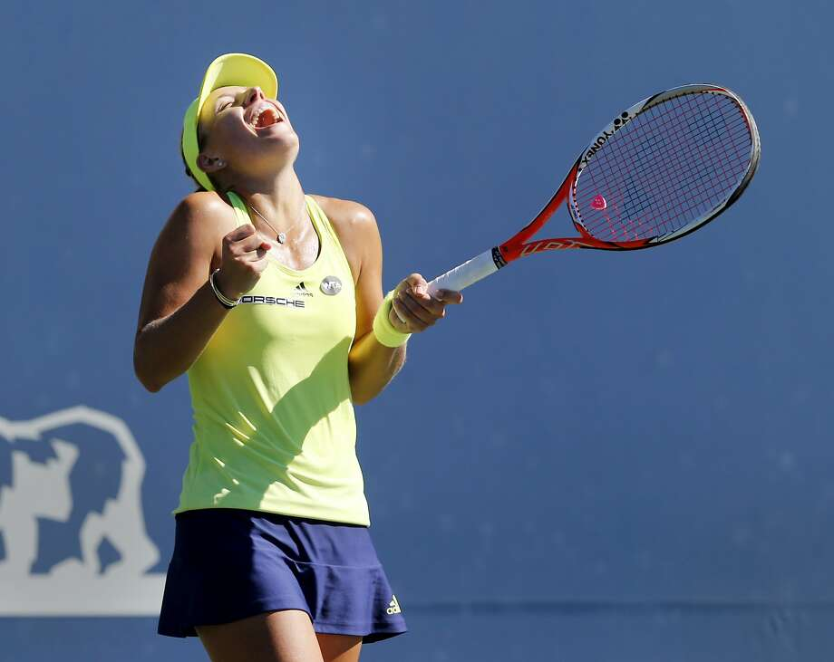 Angelique Kerber celebrates her three set victory over Karolina Pliskova. The finals of the Bank of the West tournament at Stanford featured Karolina Pliskova and Angelique Kerber Sunday August 9, 2015. Photo: Brant Ward, The Chronicle