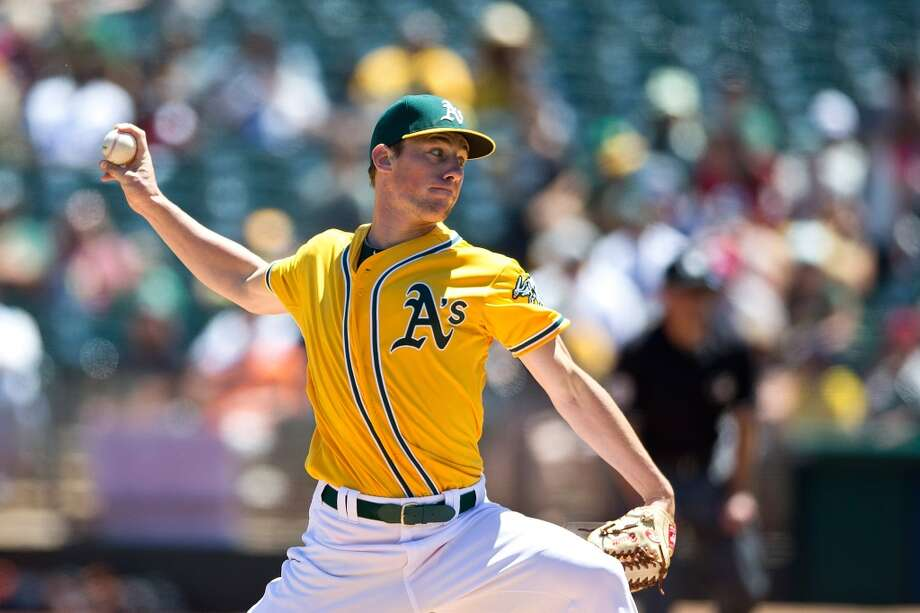 Aug. 9: Athletics 5, Astros 4 OAKLAND, CA - AUGUST 09:  Chris Bassitt #40 of the Oakland Athletics pitches against the Houston Astros during the first inning at O.co Coliseum on August 9, 2015 in Oakland, California. (Photo by Jason O. Watson/Getty Images) Photo: Jason O. Watson, Getty Images