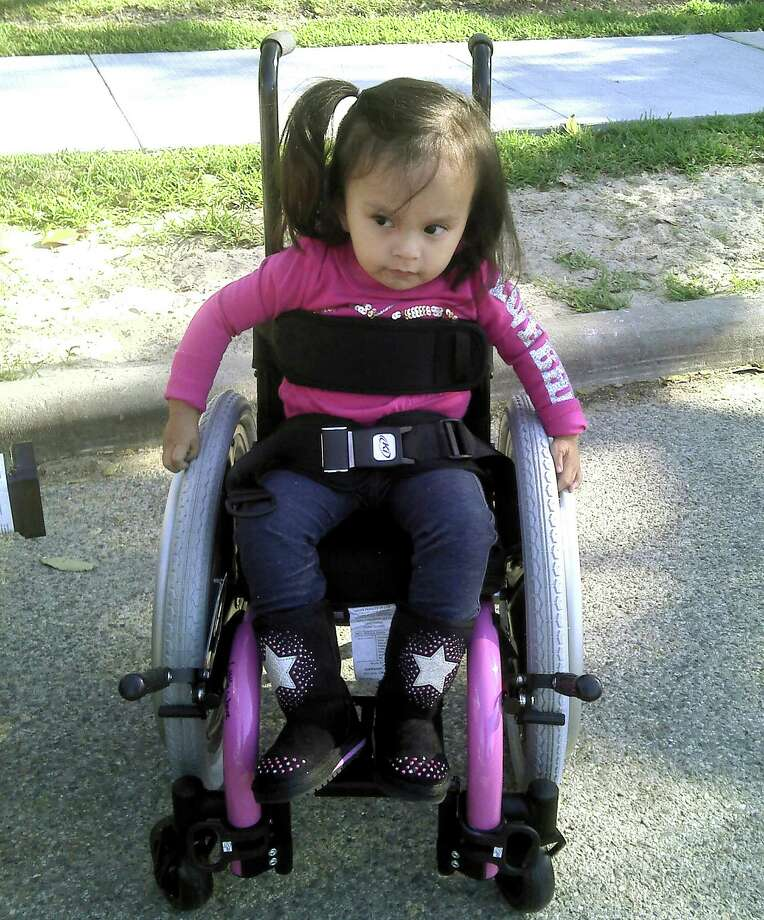 In 2011, when Ariel Reyes was 3, she relied on her wheelchair to get around. Now, after years of physical and occupational therapy, the 7-year-old with spina bifida can walk on her own.  Photo: Paulette Reyes