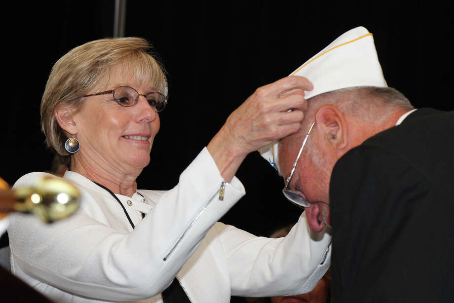 American Legion Newly elected Commander James Yermas of the Department of New York American Legion receives his commander?s hat from his wife Shirley in Buffalo. Photo: ROBERT STRONACH / ALL RIGHTS