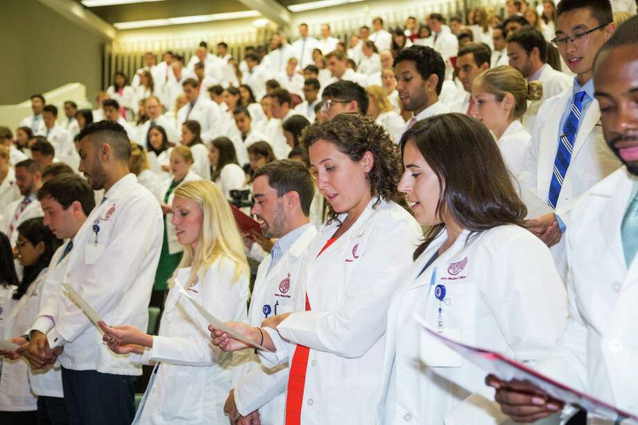 Albany Medical College's White Coat Ceremony - first year medical students are given their coats by second year students. (Photo credit Glenn Davenport) Photo: Glenn Davenport /  ©2015 Glenn Davenport