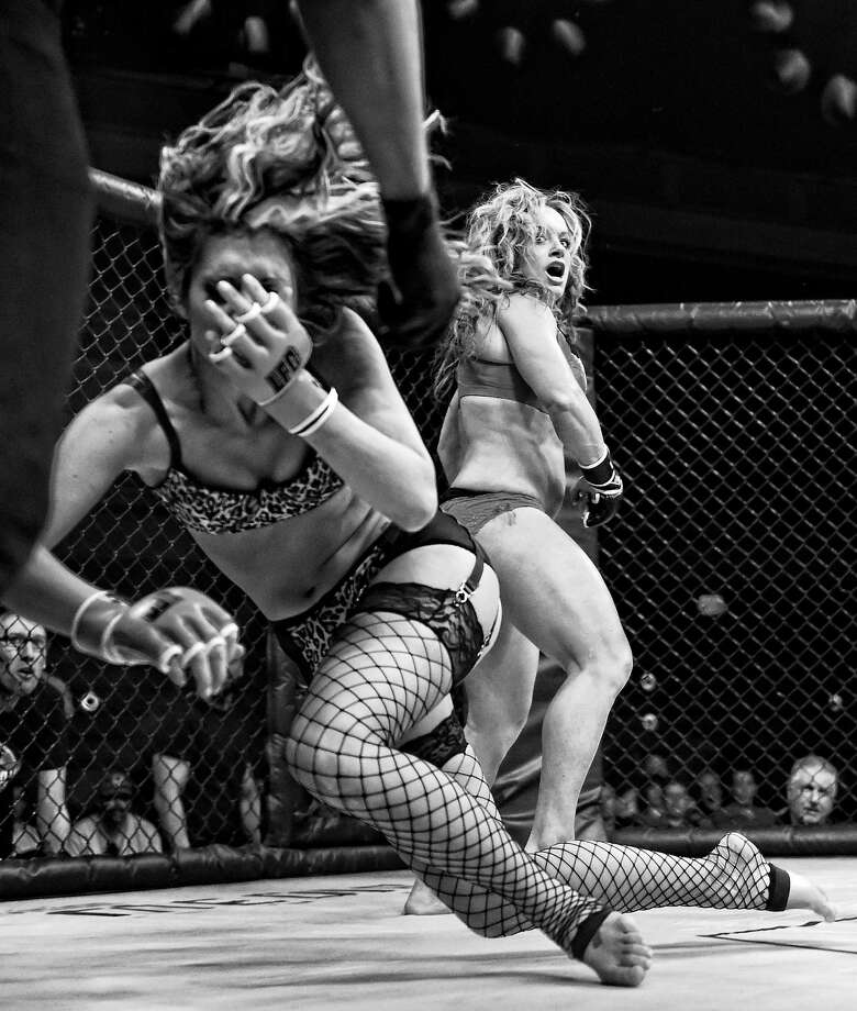 "Fighter Jenny ""Bloody"" Valentine (R) reacts after hitting Riley ""Nuclear"" Norris with an illegal punch to the face during ""Lingerie Fighting Championships 20: A Midsummer Night's Dream"" at The Joint inside the Hard Rock Hotel & Casino on August 8, 2015 in Las Vegas, Nevada. Norris won the bout when Valentine was disqualified.  (Photo by Ethan Miller/Getty Images) Photo: Ethan Miller, Getty Images  / 2015 Getty Images"