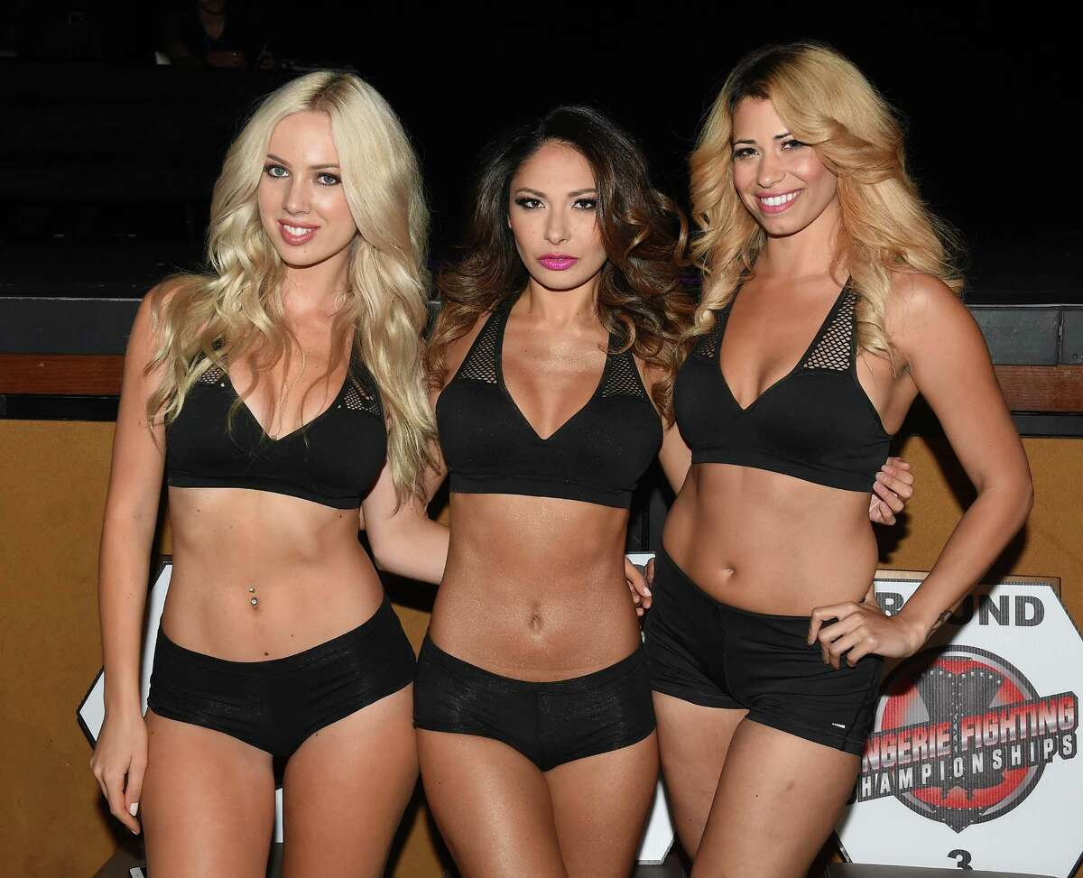 (L-R) Ring card girls Natesha Tuggle, Kat Kelley and Nya Velez pose before the start of