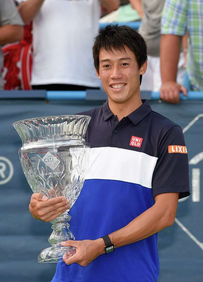 Kei Nishikori, of Japan, poses with the trophy after he defeated John Isner  in a men's singles final match at the Citi Open tennis tournament, Sunday, Aug. 9, 2015, in Washington. (AP Photo/Nick Wass) ORG XMIT: DCNW113 Photo: Nick Wass / FR67404 AP