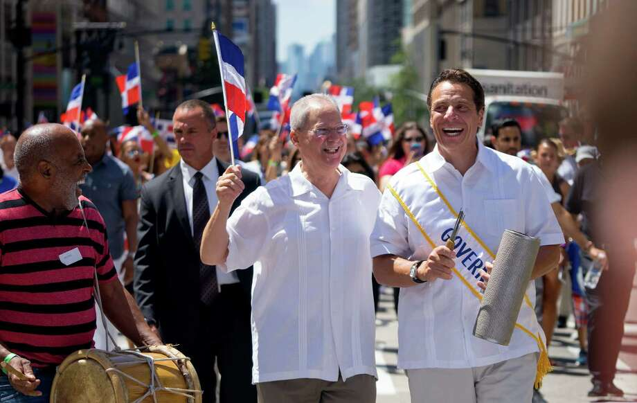 New York Gov. Andrew Cuomo, right, marches during the Dominican Day Parade Sunday, Aug. 9, 2015, in New York. (AP Photo/Craig Ruttle) ORG XMIT: NYCR109 Photo: Craig Ruttle / FR61802 AP