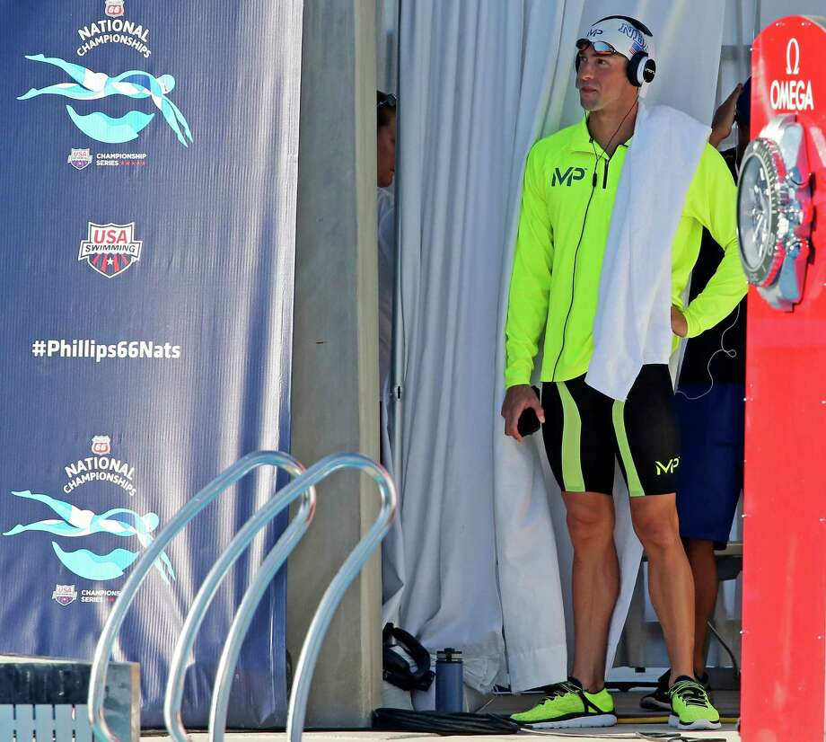 Michael Phelps waits to compete in the men's 200-meter individual medley during the 2015 Phillips 66 National Championships held Sunday Aug. 9, 2015 at the Northside Swim Center. Phelps finished first with a time of 1:54.75. Will Licon finished second with a time of 1:58.43. Travis Mahoney finished third with a time of 1:59.41. Photo: Edward A. Ornelas, Staff / San Antonio Express-News / © 2015 San Antonio Express-News