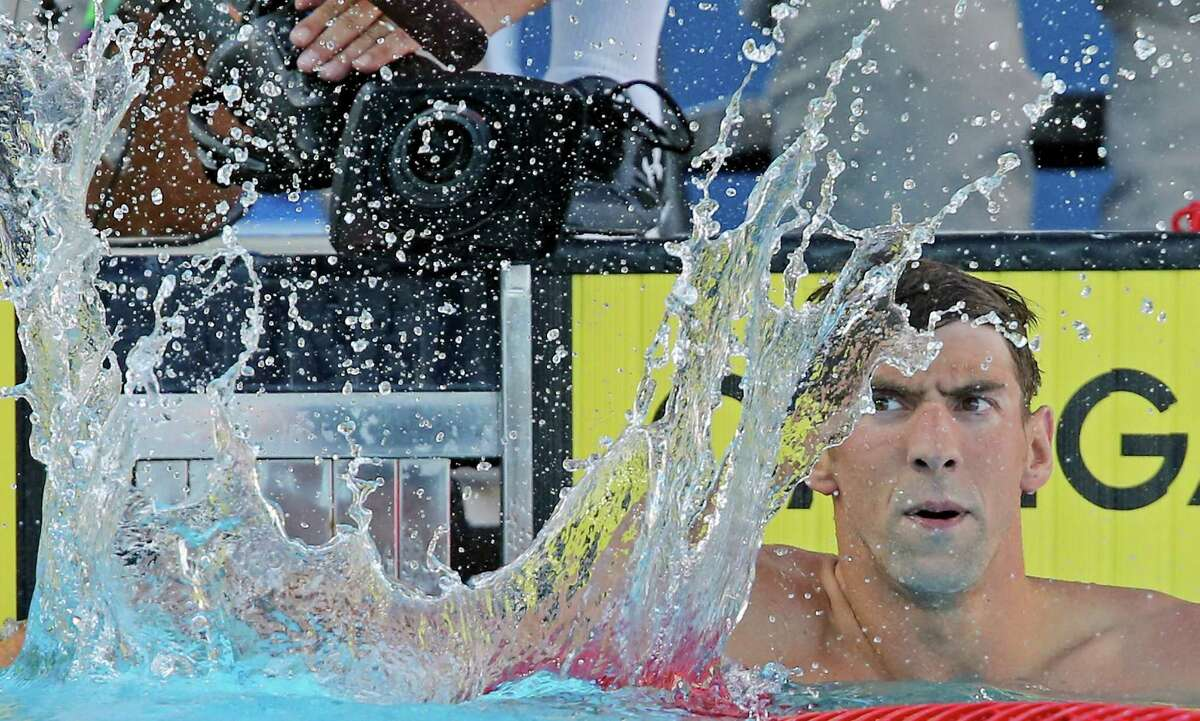 Michael Phelps reacts after competing in the men's 200-meter individual medley during the 2015 Phillips 66 National Championships held Sunday Aug. 9, 2015 at the Northside Swim Center. Phelps finished first with a time of 1:54.75. Will Licon finished second with a time of 1:58.43. Travis Mahoney finished third with a time of 1:59.41.