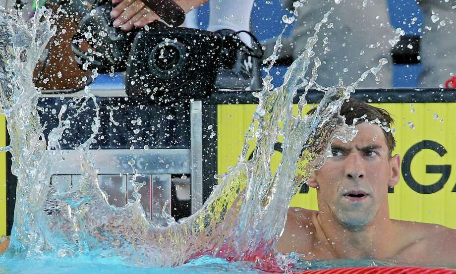 Michael Phelps reacts after competing in the men's 200-meter individual medley during the 2015 Phillips 66 National Championships held Sunday Aug. 9, 2015 at the Northside Swim Center. Phelps finished first with a time of 1:54.75. Will Licon finished second with a time of 1:58.43. Travis Mahoney finished third with a time of 1:59.41. Photo: Edward A. Ornelas, Staff / San Antonio Express-News / © 2015 San Antonio Express-News