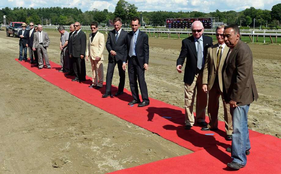 Jockey Legends of racing appeared at the Saratoga Race Course Sunday afternoon Aug. 9, 2015 in Saratoga Springs, N.Y.  Among the attendees were Angel Cordero Jr., far right, Chris McCarron, Braulio Baeza, Jacinto Vasquez, Richard Migliore to name just a few. (Skip Dickstein/Times Union) Photo: SKIP DICKSTEIN
