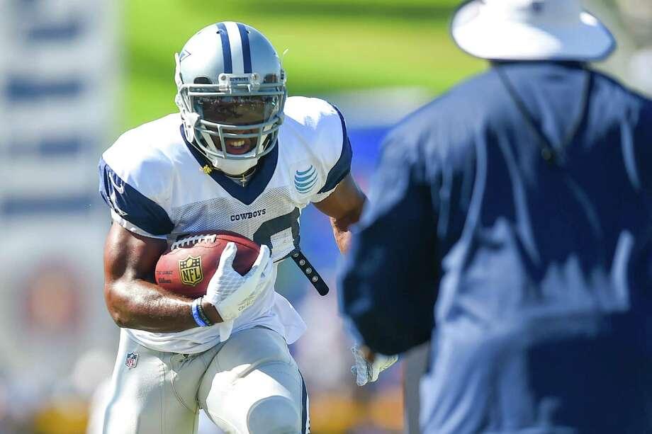 Dallas Cowboys running back Lache Seastrunk runs a drill during Dallas Cowboys' NFL training camp, Tuesday, Aug. 4, 2015, in Oxnard, Calif. (AP Photo/Gus Ruelas) Photo: Gus Ruelas, FRE / Associated Press / FR157633 AP