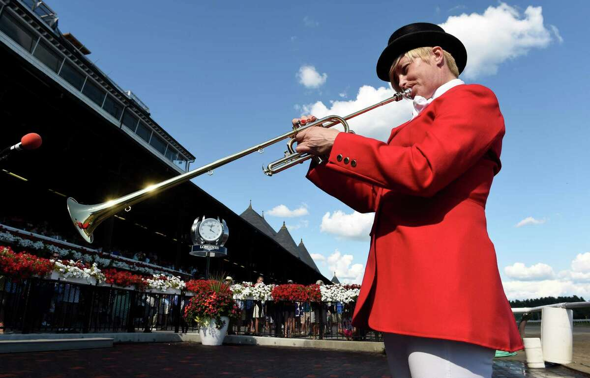 Bugler Beth Ann Dixon stands in for the missing Sammy The Bugler as she plays the parade to post Sunday afternoon Aug. 9, 2015 at the Saratoga Race Course in Saratoga Springs, N.Y. (Skip Dickstein/Times Union)