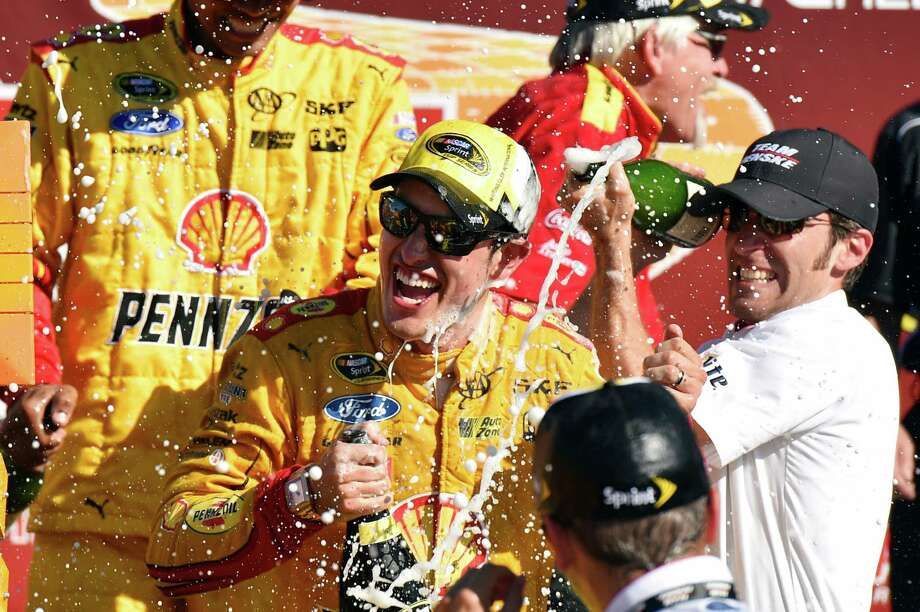 Joey Logano celebrates in the victory lane after winning a NASCAR Sprint Cup series auto race at Watkins Glen International, Sunday, Aug. 9, 2015, in Watkins Glen. N.Y. (AP Photo/Derik Hamilton) ORG XMIT: NYDH105 Photo: Derik Hamilton / FR170553 AP