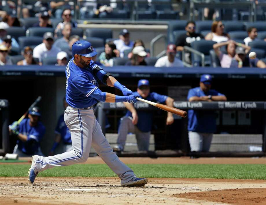 Toronto Blue Jays' Jose Bautista hits a solo home run during the fourth inning of the baseball game against the New York Yankees at Yankee Stadium, Sunday, Aug. 9, 2015, in New York. (AP Photo/Seth Wenig) ORG XMIT: NYSW105 Photo: Seth Wenig / AP