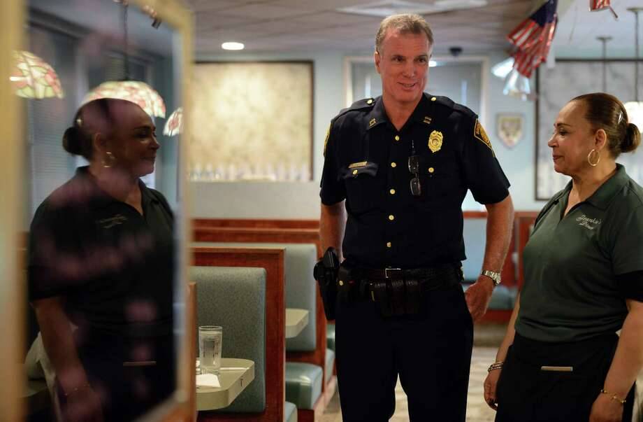 Longtime Bridgeport Police Captain Robert Gearing talks with Fatima Reyes last monthat Frankie's Diner, where he eats lunch at least twice a week. Gearing is retiring from the police department after 25 years. Photo: Autumn Driscoll / Hearst Connecticut Media / Connecticut Post