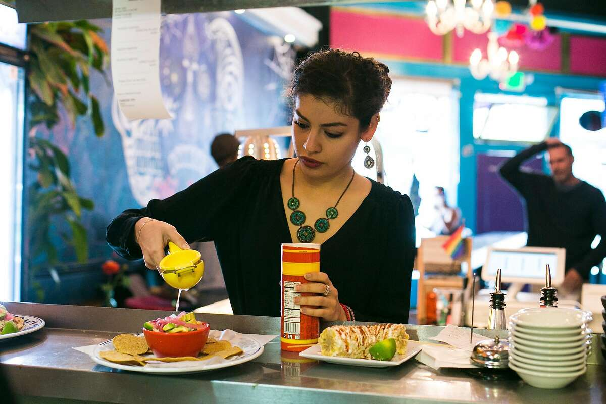 Julia Barrios squeezes a lime for a guest at Tacorgasmico.
