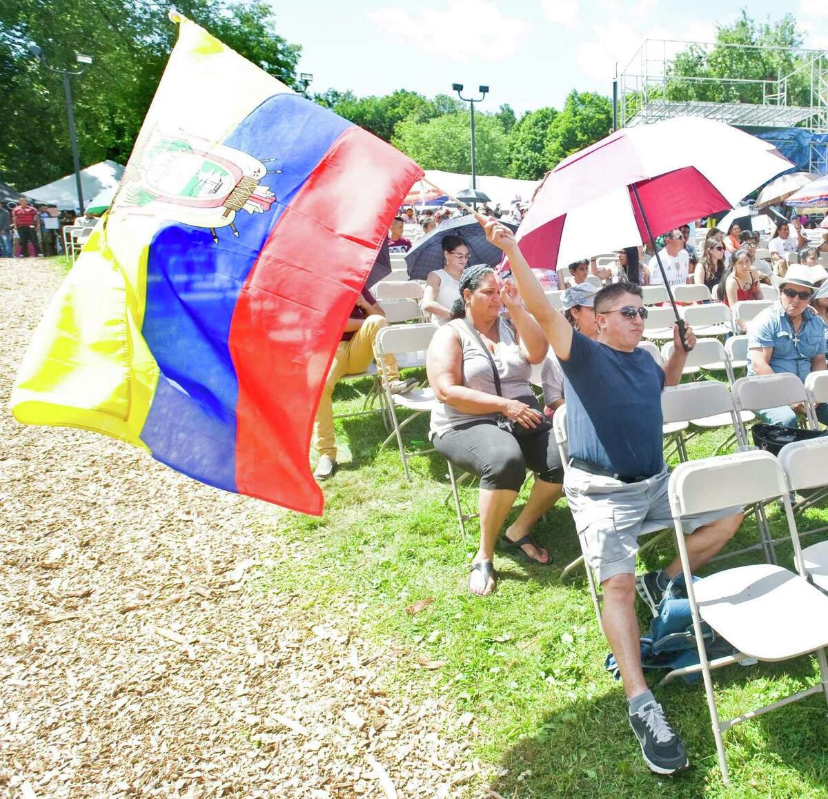 Angel Capon waves the flag of Ecuador at the annual Ecuadorian festival held at the Ives Concert Park in Danbury. Sunday, Aug. 9, 2015